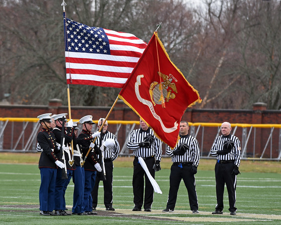 RYAN HUTTON/ Staff photo<br /> The Haverhill High School Marine Corps JROTC color guard holds the American flag during the national anthem prior to Haverhill's Thanksgiving game at Trinity Stadium in against Lowell. Haverhill won 28-7.