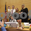 TIM JEAN/Staff photo <br /> <br /> In center, Mason Greene, 5, sits in the judges chair as his parents Krissy and Stephen Greene, holding his sister Isla, of Braintree, pose photo a photo with judge Kerry A. Ahern, Essex County Juvenile Court during a National Adoption Day ceremony held at the Fenton Judicial Center in Lawrence.     11/22/19