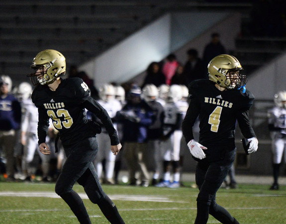 CARL RUSSO/Staff photo. Haverhill exchange student and Hillie kicker Jakob Wimmer, left of Germany and Dryden Fisher walk off the field after Wimmer kicked another extra point with Fisher holding for him. Haverhill defeated Lexington 42-28 in Friday night football action. 11/15/2019