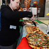 CARL RUSSO/Staff photo. Meghan McLaughlin of Haverhill tries another slice of Florentine pizza from La Pizza Di Forno located on Merrimack Street. Some of the ingredients include baby spinach, red onions, tomatoes and mozzarella cheese with a drizzle of  Balsamic vinegar.<br /> <br /> The Exchange Club of Haverhill presented their annual Food, Fun and Flare from Around the World fund raiser on Thursday, June 13. Proceeds from this springtime fundraiser benefited Haverhill's local Boys & Girls Club, YMCA, YWCA in addition to Exchange Club. <br /> <br /> The unique event stimulated taste buds with foods from across the globe: China, Greece, France, Italy, Mexico and southern United States to name a few. <br /> <br /> The 13 restaurants that participated are: G's,  Mark's Deli, Keon's 105 Bistro, Battlegrounds Coffee Co., The Lasting Room, Wang's Table, Hans Garden, La Pizza Di Forno, Olivia's, Butch's Uptown, Maria's Family Restaurant, The Peddler's Daughter and Casa Blanca. Each  restaurants featured ethnically-themed small plates from different areas of the world. 6/13/2019