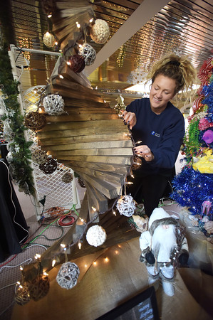 TIM JEAN/Staff photo <br /> <br /> Riley O'Brien from Princeton Properties in Lawrence, adds lights to her company's tree as they sets up for the annual Festival of Trees in Methuen.         11/15/19