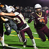 CARL RUSSO/Staff photo. Whittier's A.J. Espinal runs hard with the ball while getting a block from Dylan Fraize against Reggie, Maxime Cezard (63). Whittier Wildcats defeated the Greater Lawrence Reggies in Thanksgiving Eve football action. 11/27/2019