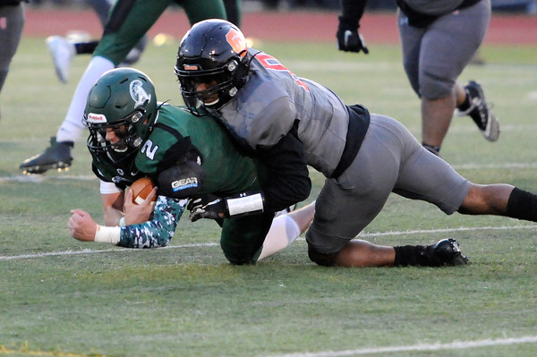 TIM JEAN/Staff photo <br /> <br /> Greater Lawrence's Franklyn Espinal sacks Abington quarterback Colby Augusta for a loss during the Division 7 semifinal football game in Woburn. Greater Lawrence lost 33-22.  11/23/19