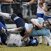 TIM JEAN/Staff photo <br /> <br /> Methuen linebacker Joseph Pinto tackles Dracut wide receiver Kyle Cox after a short gain during the annual Thanksgiving day football game at Dracut High School. Methuen won 50-40.  11/28/19