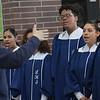 TIM JEAN/Staff photo <br /> <br /> Nancy McGhee, left, conducts the Lawrence High School One Voice Ensemble during a National Adoption Day ceremony held at the Fenton Judicial Center in Lawrence.     11/22/19