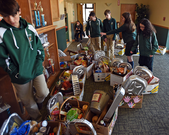 RYAN HUTTON/ Staff photo<br />  St. Joseph Regional Catholic School students count up donation boxes full of Thanksgiving foods on Monday.