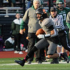 TIM JEAN/Staff photo <br /> <br /> Greater Lawrence quarterback Shamil Diaz runs for a big gain on the keeper against Abington during the Division 7 semifinal football game in Woburn. Greater Lawrence lost 33-22.  11/23/19