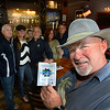 CARL RUSSO/Staff photo. Bob Trepanier shows his passport while participants in the The Exchange Club of Haverhill's annual Food, Fun and Flare from Around the World gather at Butch's Uptown restaurant. The passport granted people a tasting from each of the 13 restaurants on the tour.<br /> <br /> The Exchange Club of Haverhill presented their annual Food, Fun and Flare from Around the World fund raiser on Thursday, June 13. Proceeds from this springtime fundraiser benefited Haverhill's local Boys & Girls Club, YMCA, YWCA in addition to Exchange Club. <br /> <br /> The unique event stimulated taste buds with foods from across the globe: China, Greece, France, Italy, Mexico and southern United States to name a few. <br /> <br /> The 13 restaurants that participated are: G's,  Mark's Deli, Keon's 105 Bistro, Battlegrounds Coffee Co., The Lasting Room, Wang's Table, Hans Garden, La Pizza Di Forno, Olivia's, Butch's Uptown, Maria's Family Restaurant, The Peddler's Daughter and Casa Blanca. Each  restaurants featured ethnically-themed small plates from different areas of the world. 6/13/2019