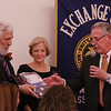"""MIKE SPRINGER/Staff photo<br /> Methuen Exchange Club President Jack MacLeod presents a new flag to Michael and Joanne Armano while honoring them with the """"Proudly We Hail"""" award Tuesday during the club's 25th Recognition Dinner and Awards Night at the Merrimack Valley Golf Club.<br /> 11/19/2019"""