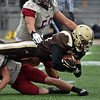 RYAN HUTTON/ Staff photo<br /> Haverhill's Disani Houston dives with the ball during the second quarter of Thursday's Thanksgiving game at Trinity Stadium in Haverhill. Haverhill beat Lowell 28-7.