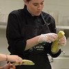 TIM JEAN/Staff photo <br /> <br /> Pinkerton Academy CTE student Lily Mendes prepares a dish for the MRE Chopped Challenge, a cooking competition at Salem High School. The event was hosted by New Hampshire Department of Education and New Hampshire Army National Guard.   11/20/19
