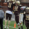 RYAN HUTTON/ Staff photo<br /> Haverhill's Teyshon McGee, left, celebrates a touchdown by Aiden Alvarado, right, during the second quarter of Thursday's Thanksgiving game at Trinity Stadium in Haverhill. Haverhill beat Lowell 28-7.