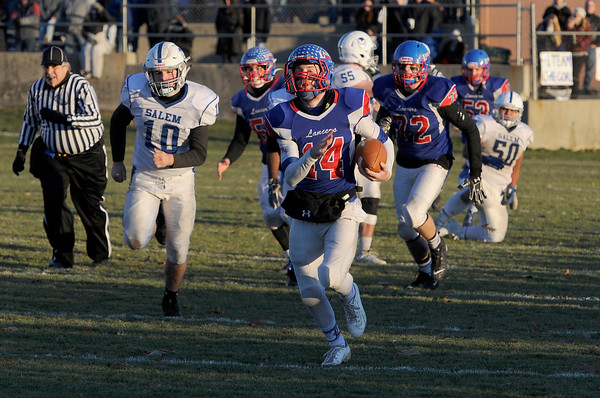 TIM JEAN/Staff photo <br /> <br /> Londonderry quarterback Jake McEachern runs for a 66 yard touchdown against Salem during the New Hampshire Division 1 semifinal football game. Londonderry won 35-14.     11/16/19