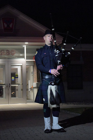 TIM JEAN/Staff photo <br /> <br /> Captain Patrick Cheetham of the Londonderry Police Department plays the bagpipes as they welcome a piece of the World Trade Center during a ceremony held at Londonderry's Central Fire Station.       11/15/19