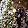 """TIM JEAN/Staff photo <br /> <br /> Jessica Napier, a member of the First Church Congregational adds to the tree """"Oh Holy Night"""" as she sets up her tree for the annual Festival of Trees in Methuen.         11/15/19"""