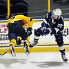 CARL RUSSO/Staff photo. Merrimack's  Zach Uens is checked hard by Penn State's Connor MacEachern. Merrimack College was defeated by Penn State in men's hockey Friday night. 11/29/2019