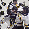 TIM JEAN/Staff photo <br /> <br /> Merrimack's Ben Brar celebrates with his teammates after scoring a goal against RPI during the first period of a Mens Ice Hockey game at Merrimack College.       11/30/19