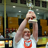 CARL RUSSO/Staff photo. David Tweedie, 2019 North Andover high school graduate holds his trophy up high after winning his wrestling match. <br /> <br /> The 6th. annual North Andover Wrestle 'Lympics was held Friday night at North Andover high school. High school varsity and middle school wrestlers competed against challenged wrestlers to benefit the Best Buddies program. 11/22/2019