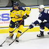 CARL RUSSO/Staff photo. Merrimack's captain, Sami Tavernier controls the puck as Penn State's Sam Sternschein gives chase. Merrimack College was defeated by Penn State in men's hockey Friday night. 11/29/2019