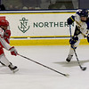 TIM JEAN/Staff photo <br /> <br /> Merrimack's Jacob Moody shoots the puck towards the goal against RPI during the first period of a Mens Ice Hockey game at Merrimack College.       11/30/19