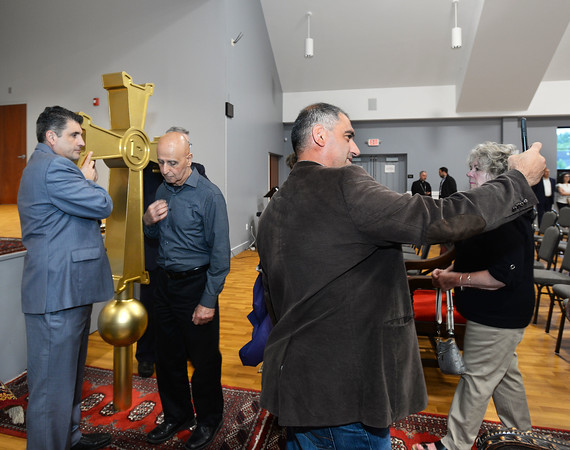 CARL RUSSO/Staff photo. As Arthur Derderian, left of Methuen a member of the church blesses himself in front of the cross, another man takes a selfie. <br /> <br /> Nigoghos Atinizian, far left and Argishti Chaparian (hidden) representing the Knights of Vartan Ararat Lodge in Boston served as a honor guard for the cross during the service. The Knights of Vartan Ararat Lodge donated the cross. <br /> <br />  The Armenian Apostolic Church at Hye Pointe in Haverhill consecrated its sanctuary cross and placed it on top of the dome Thursday, June 20. A reception was held after the service. 6/20/2019. <br /> <br />  Fr. Vart Gyozalyan, pastor of the Armenian Apostolic Church at Hye Pointe and special guest Bishop Daniel Findikyan of the Diocese of the Armenian Church of America (Eastern) in New York along with a dozen priest and deacons held a service to bless the cross and the people attending. A reception was held after the service.  6/20/2019
