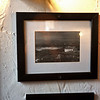 RYAN HUTTON/ Staff photo<br /> A picture of the Conneely land back in Ireland hanging on the wall of the Peddler's Daughter, owned by Michael Conneely and his family.