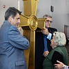 CARL RUSSO/Staff photo. Victoria Mrzian, 86, blesses herself in front of the cross. Nigoghos Atinizian, left and Argishti Chaparian representing the Knights of Vartan Ararat Lodge in Boston served as a honor guard for the cross during the service. The Knights of Vartan Ararat Lodge donated the cross. <br /> <br />  The Armenian Apostolic Church at Hye Pointe in Haverhill consecrated its sanctuary cross and placed it on top of the dome Thursday, June 20. A reception was held after the service. 6/20/2019. <br /> <br />  Fr. Vart Gyozalyan, pastor of the Armenian Apostolic Church at Hye Pointe and special guest Bishop Daniel Findikyan of the Diocese of the Armenian Church of America (Eastern) in New York along with a dozen priest and deacons held a service to bless the cross and the people attending. A reception was held after the service.  6/20/2019