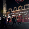 TIM JEAN/Staff photo <br /> <br /> Londonderry Fire officials walk with Catherine Christman from the Tunnel to Towers Foundation and members of the Patriot Riders Honor Guard as they wheel in a piece of the World Trade Center in to Londonderry's Central Fire Station.       11/15/19