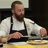 TIM JEAN/Staff photo <br /> <br /> Judge David Crinieri, from Tuscan Brands in Salem, tastes a dish for the CTE students made during the MRE Chopped Challenge, a cooking competition at Salem High School. The event was hosted by New Hampshire Department of Education and New Hampshire Army National Guard.   11/20/19