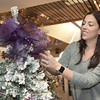 TIM JEAN/Staff photo <br /> <br /> Jenny Bouren, of Haverhill adds a purple bow to the top of her tree as she sets up for the annual Festival of Trees in Methuen.         11/15/19
