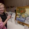 TIM JEAN/Staff photo <br /> <br /> Carolyn Hughes, of Andover, makes a bid on a Painting Donated By: Jackie Cunningham using her phone in the live auction part of Lazarus House annual ''Sharing Our Bounty'' Gala held at the Andover Country Club.  11/16/19