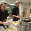 TIM JEAN/Staff photo <br /> <br /> Salem's CTE students Brendan Capsalis, left, and David Edge prepare a chicken quesadillas for the MRE Chopped Challenge, a cooking competition at Salem High School. The event was hosted by New Hampshire Department of Education and New Hampshire Army National Guard.   11/20/19