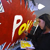 """RYAN HUTTON/ Staff photo<br /> Maria Cacoj, 17, paints part of Whittier Tech's parade float in preparation for Sunday's VFW Santa Parade in Haverhill. This year's theme is """"heroes""""."""
