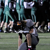 TIM JEAN/Staff photo <br /> <br /> Greater Lawrence quarterback Shamil Diaz takes a knee as Abington players celebrate winning the Division 7 semifinal football game in Woburn. Greater Lawrence lost 33-22.  11/23/19