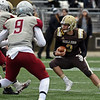 RYAN HUTTON/ Staff photo<br /> Haverhill quarterback Brady Skafas looks for an opening in the Lowell line during the first quarter of Thursday's Thanksgiving game at Trinity Stadium in Haverhill. Haverhill beat Lowell 28-7.