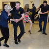 CARL RUSSO/Staff photo. Greg Clarkson of Freemont N.H. shows Paula Ruelle of Ipswich some steps. Peter Dryden of Haverhill (background) dances with Jasmine Menna of Haverhill. Members of the  North Shore Swing dance and Swing City socialize and dance at Veasey Park Hall in Groveland on Monday nights.   <br /> <br /> The North Shore Swing dance and Swing City Second Annual Vintage Holiday Gala will be held on December 14 at Newburyport City Hall. 11/25/2019