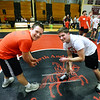 CARL RUSSO/Staff photo. Jack Perry, right, NAHS graduate and a junior at UMass Amherst on the wrestling mat with his brother Zane Perry, a junior at NAHS. Jack started the North Andover Wrestle 'Lympics six years ago.  <br /> <br /> The 6th. annual North Andover Wrestle 'Lympics was held Friday night at North Andover high school. High school varsity and middle school wrestlers competed against challenged wrestlers to benefit the Best Buddies program. 11/22/2019 <br /> <br /> The 6th. annual North Andover Wrestle 'Lympics was held Friday night at North Andover high school. high school varsity and middle school wrestlers competed against challenged wrestlers to benefit the Best Buddies program. 11/22/2019