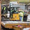 RYAN HUTTON/ Staff photo<br /> Crews work in a trench in the area of Florence Street in Lawrence where a contractor struck a low pressure gas line.