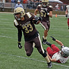 RYAN HUTTON/ Staff photo<br /> Haverhill's Jancarlos Figueroa breaks a Lowell tackle during the first quarter of Thursday's Thanksgiving game at Trinity Stadium in Haverhill. Haverhill beat Lowell 28-7.