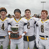 MIKE SPRINGER/Staff photo<br /> Andover captains, from left, Shamus FLorio, Kelvin Davila, Michael Slayton and Matt Comeau pose for photographs with the Thanksgiving Day game trophy after defeating rival North Andover Thursday at North Andover.<br /> 11/27/2019