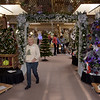 TIM JEAN/Staff photo <br /> <br /> Maureen Pollard walks among finished trees as participants set up for the annual Festival of Trees in Methuen.         11/15/19