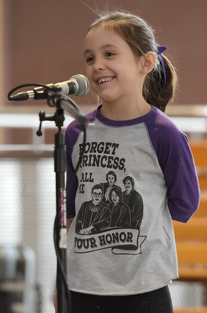 TIM JEAN/Staff photo <br /> <br /> Hazel Lummus, 7, who also was adopted talks about some of the best things about being adopted, like having two birthdays during a National Adoption Day ceremony held at the Fenton Judicial Center in Lawrence.     11/22/19