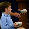 CARL RUSSO/staff photo. Cardinal Sean P. O'Malley, OFM Cap. celebrated mass Tuesday night at St. Michael's Parish in honor of their 150th anniversary. A young boy participates in the preparing of holy communion. 11/19/2019