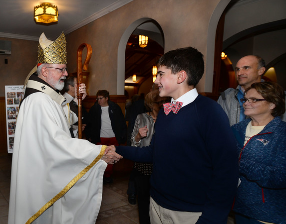 CARL RUSSO/staff photo. Cardinal Sean P. O'Malley, OFM Cap. celebrated mass Tuesday night at St. Michael's Parish in honor of their 150th anniversary. The cardinal greets people after the mass. 11/19/2019