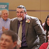 MIKE SPRINGER/Staff photo<br /> Neil Wilkins, a teacher at Greenleaf Academy, has a look of surprise as he stands to receive the Educator of the Year Award during the Haverhill YMCA's recognition event Tuesday evening at Northern Essex Community College.<br /> 11/19/2019