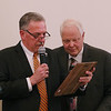 MIKE SPRINGER/Staff photo<br /> Methuen Exchange Club President Jack MacLeod, left, reads the inscription on the Veteran's Service Award plaque to recipient Donald Campbell Tuesday during the club's 25th Recognition Dinner and Awards Night at the Merrimack Valley Golf Club.<br /> 11/19/2019