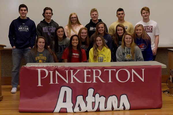 TIM JEAN/Staff photo <br /> <br /> Pinkerton Academy sports students gather on stage for a group photo during a letter of intent for college signing at the school. Students standing from left to right, Jonathon Holland, lacrosse; St. Anselm, Brady Day, baseball; Kansas State, Alyssa DiMauin, softball; SNHU, Mason Drouin, lacrosse; Bryant, Nathan Laliberte, lacrosse; Bryant, and Connor McCormack, lacrosse; Franklin Pierce. Middle row from left, to right, Mari Shea, field hockey; UNH, Marley Mailoux, field hockey; Providence, Lauren Lisauskas, lacrosse; Georgetown, Zoe Howe, lacrosse; Mt. Olive, and Hailey Peredna, lacrosse; UMass Lowell. Seated from left to right, Madison Daziel, lacrosse; Winthrop, Sarah Collins, field hockey; Sacred Heart University, Kate Bennett, field hockey; Merrimack College, and  Lily Auger, lacrosse; Bryant University.    11/14/19