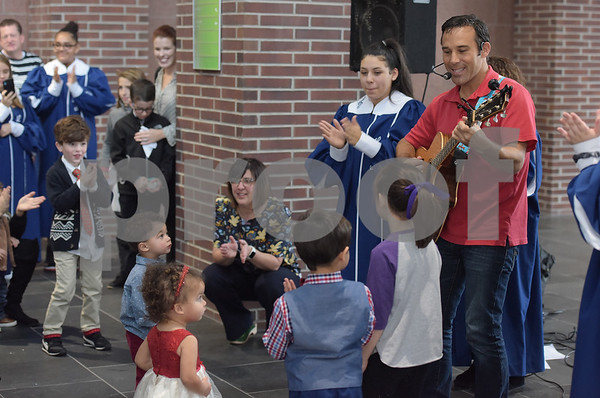 TIM JEAN/Staff photo <br /> <br /> Entertainment was performed by Steve Songs, who plays children sing-alongs during a National Adoption Day ceremony held at the Fenton Judicial Center in Lawrence.     11/22/19