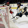 TIM JEAN/Staff photo <br /> <br /> Merrimack's Tyler Drevitch, right, looks to score against RPI during the first period of a Mens Ice Hockey game at Merrimack College.       11/30/19