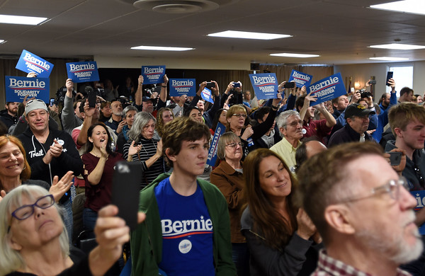 RYAN HUTTON/ Staff photo<br /> A crowd of a couple hundred people give a standing ovation to Vermont Senator Bernie Sanders as he enters a town hall-style campaign stop at the Derry-Salem Elks Lodge on Monday afternoon.